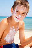 Boy with sunscreen on face