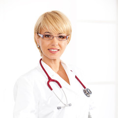 Female doctor standing on isolated background