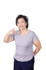 Asian senior female giving you thumbs up over white background,