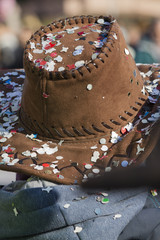 confetti on the hat to the carnival