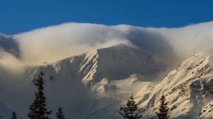 clouds rolling over ridge, Carpathian mountains