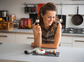 Happy young woman eating camembert