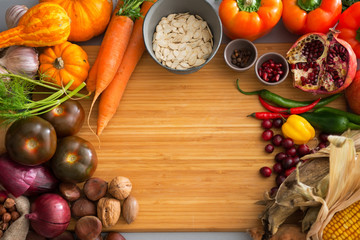 Closeup on autumn vegetables on cutting board