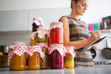 Closeup on jars with homemade fruits jam and pickled vegetables