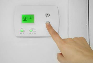 AC thermostat adjust