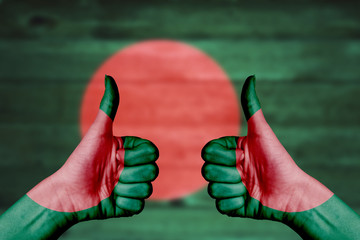 Bangladesh flag painted on female hands thumbs up