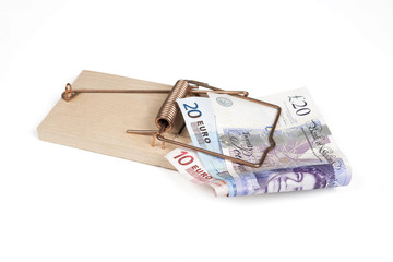 Mouse trap with Euro and Pound bills with clipping path.