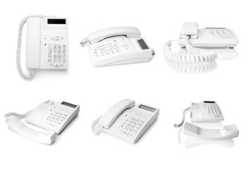 collection of white telephones on white