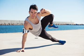 Fit male athlete doing sport exercise