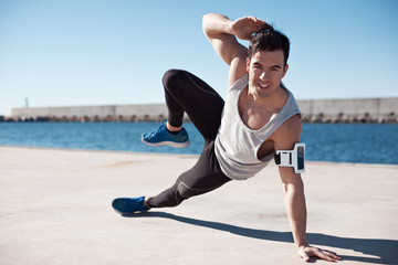 Fit smiling athlete doing sport exercise