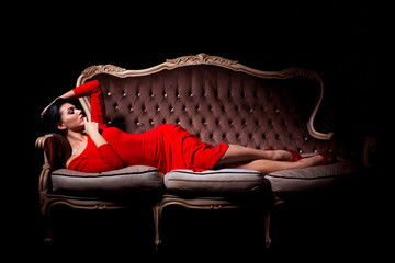 Elegant woman posing on sofa