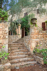 Stone staircase leading to old mansion.