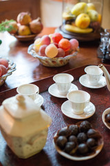 Tea, cups and sweets on the table.