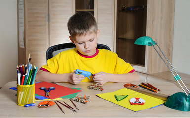 Child making Christmas decorations. Craft. Hobby.