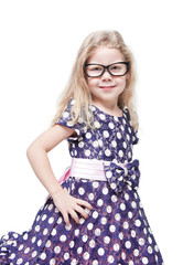 Smart beautiful little girl in glasses isolated
