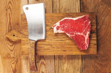 Beautiful and juicy steak on wooden board with cleaver