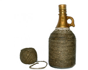 decorative bottle wrapped a linen twine isolated on a white back