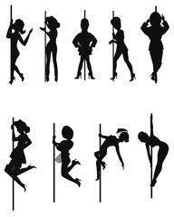 dancers on the pole in silhouette