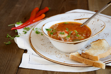 Gumbo soup on wooden background
