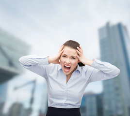 angry screaming businesswoman outdoors