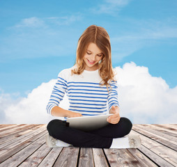 happy little student girl with tablet pc
