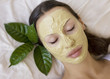 Woman with Indian Multani Matti clay facial mask, beauty spa