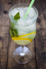 mojito cocktail with a lemon and mint