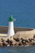 Beacon, pier, sea. Cagliari, Sardinia