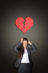 Businesswoman in Despair with Broken Heart Above