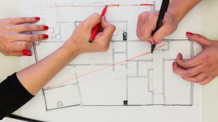 Creative Female interior designers drawing interior design plan
