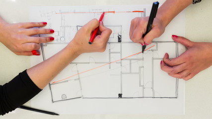Creative Female interior designers drawing interior design plan