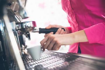 Waitress making coffee