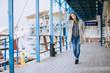 Pretty fashion young woman posing in a dock