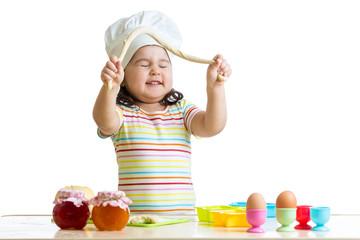 happy child having fun preparing a pie