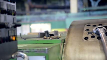 Machine operator is adjusting an industrial machine