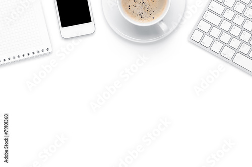 Office desk table with computer, supplies and coffee cup - 79101368