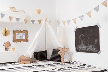 Playroom for kids with Teepee and garlands