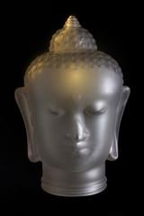 Buddha head on black background