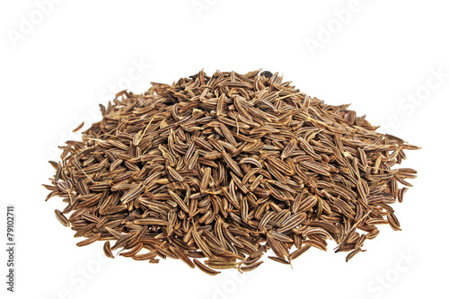 Pile of cumin seeds on a white background