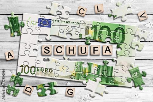 Leinwanddruck Bild Geldscheinpuzzle - Schufa