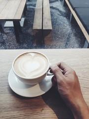 hand and coffee