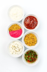 Variety of sauces in white bowls