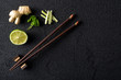 Chopsticks and food ingredients on black stone table top view - 79103748