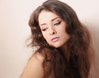 Beautiful romantic makeup woman looking down with long hair
