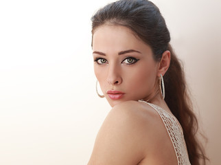 Beautiful woman with makeup green eyes looking sexy