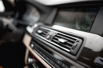 modern car interior with close-up of ventilation system holes