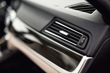 Car ventilation system with adjustment buttons and details