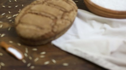 Freshly baked organic sourdough rye bread on wooden table