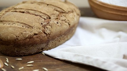 Freshly baked homemade sourdough rye bread on wooden table