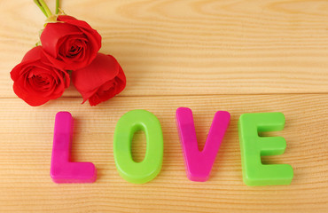 Decorative letters forming word LOVE with flowers